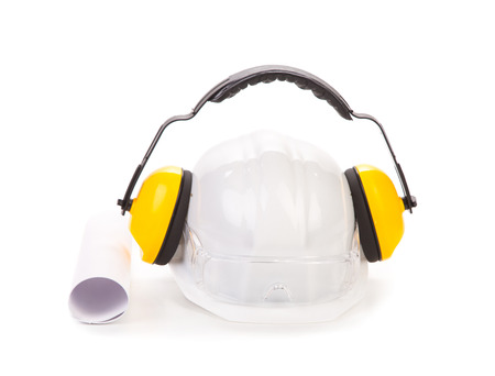 Hard hat and ear muffs. Isolated on a white background. photo