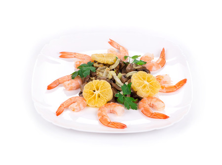 haute cuisine: Shrimp salad with mushrooms as haute cuisine. Isolated on a white background.
