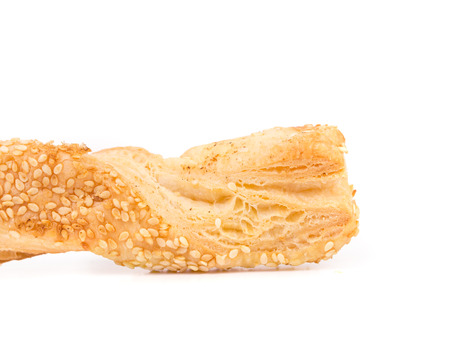 sesame cracker: Cheese stick cracker with sesame seeds. Isolated on a white background.