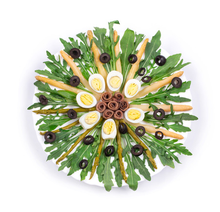 haute cuisine: Salad with anchovies and asparagus as haute cuisine. On a white background.