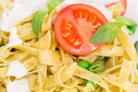 haute cuisine: Pasta with dressing and green beans as haute cuisine. Whole background. Stock Photo