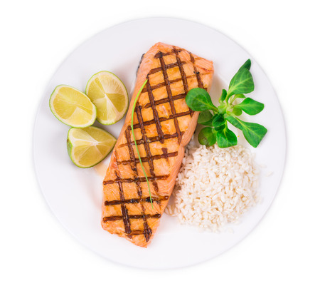 haute cuisine: Roasted salmon fillets with rice as haute cuisine. Whole background.