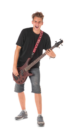 chap: Bass guitarist. Isolated on the white background.