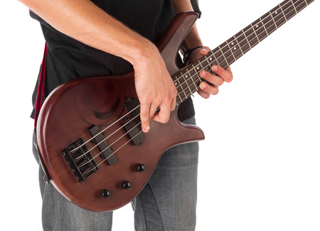 bloke: Bass guitarist. Isolated on the white background.