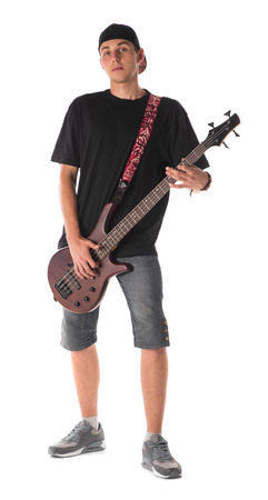 staging: Bass guitarist. Isolated on the white background.