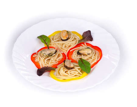 haute cuisine: Tasty italian pasta with seafood as haute cuisine. Isolated on a white background.