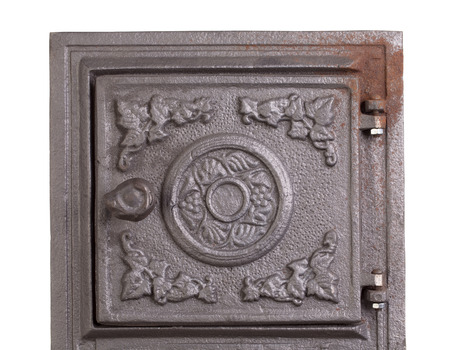 firebox: Cast iron door for furnaces. Fragment. Close up. Stock Photo