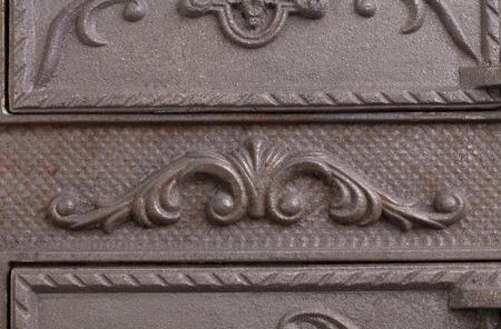 fasade: Cast iron door for furnaces. Fragment. Close up. Stock Photo
