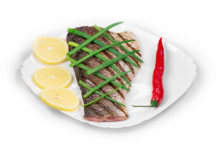 pikeperch: Grilled Fish Fillet with Vegetables on a plate isolated