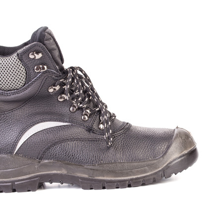 Black mans boot with gray bar. Isolated on a white background. photo