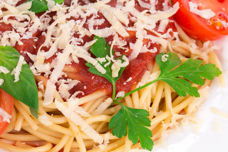 haute cuisine: Pasta with tomato sauce as a haute cuisine. Isolated on a white background. Stock Photo