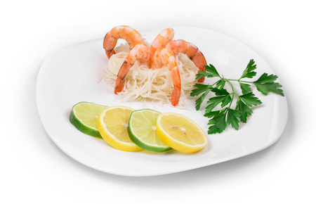 haute cuisine: Fresh unshelled boiled shrimps with spaghetti as haute cuisine. Isolated on a white background.