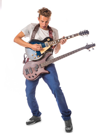 chap: Musician and two guitar. Isolated on the white .