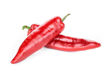 capsaicin: Red chili peppers. Isolated on a white .
