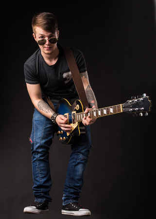 staging: Lead guitarist. Located on the black . Stock Photo
