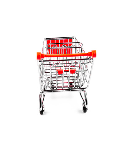 Shopping cart isolated on white background in closeup photo