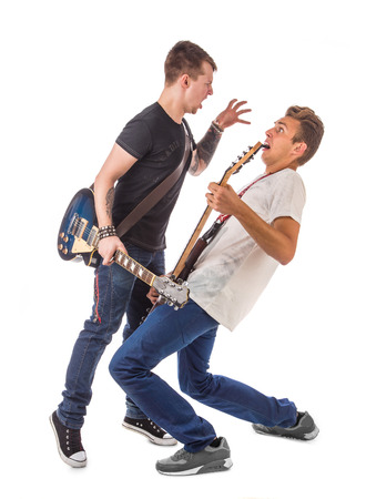 staging: Lead and bass guitarist. Located on the white background. Stock Photo