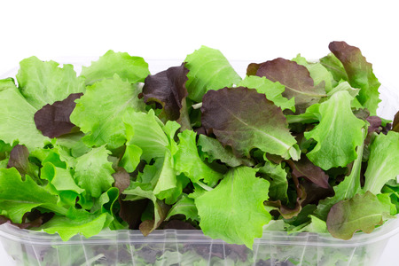 Mix salad in box. Isolated on a white background.
