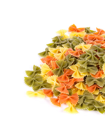 nutriment: Bunch of the farfalle pasta three colors. Whole background. Stock Photo