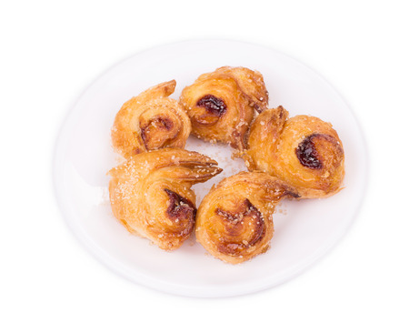 buttery: Croissants or crescent rolls on a plate. Isolated on a white background.