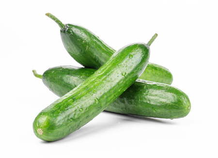 Three fresh cucumbers. Isolated on a white background.
