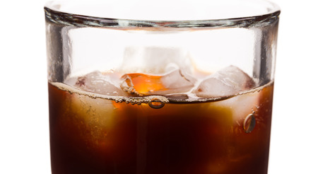 Cola with Ice. Food background in the closeup. photo