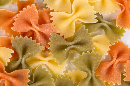 enriched: Heap of farfalle pasta. Close up. Whole background.