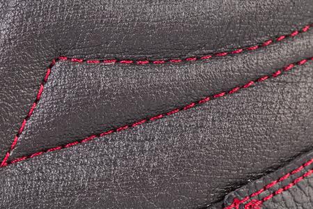 stitch: Close up of red stitch. Whole background.