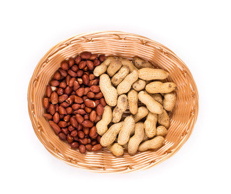 hard core: Basket full with peanuts. Isolated on a white background. Stock Photo