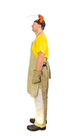 protective clothing: Welder with protective clothing. Isolated on a white background.