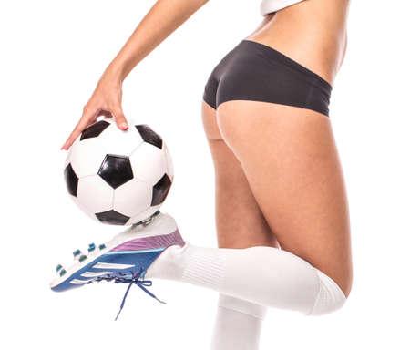 Female model. Soccer isolated on the white background.