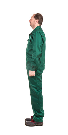 Man in green uniform. Isolated on a white background. photo