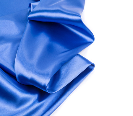 sensuous: Blue silk drapery. Isolated on a white background.