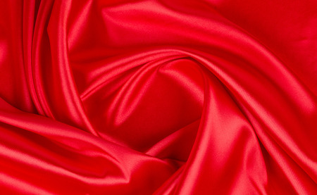 Red silk drapery. Isolated as a whole background.