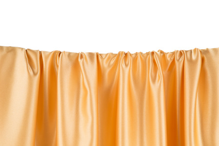 satiny cloth: Golden silk drapery. Isolated as a whole background.