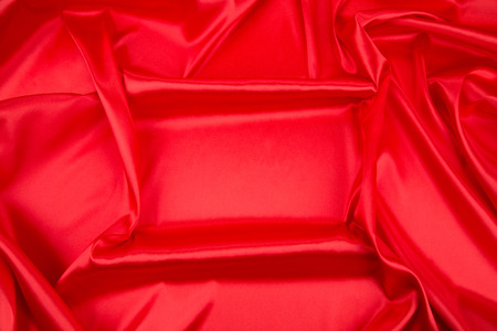 satiny: Red silk drapery. Isolated as a whole background.