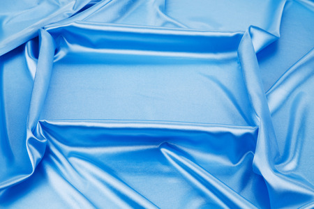 Blue silk drapery. Isolated as a whole background.