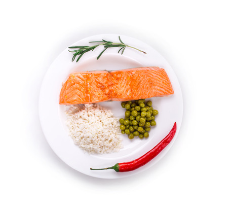 rice plate: Grilled salmon fillet with risotto and peas on a plate. Isolated white background.