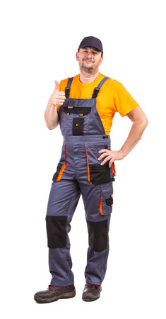 happy worker: Happy worker wearing overalls. Isolated on a white background.
