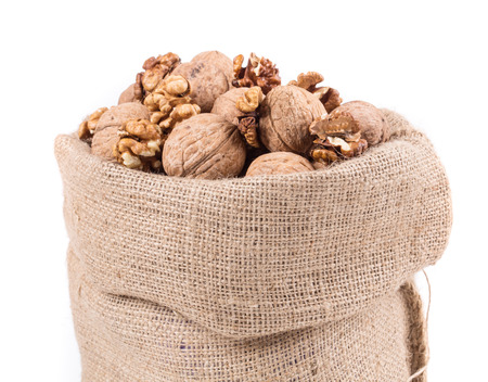 burlap bag: Walnuts in burlap bag. Isolated on a white background.