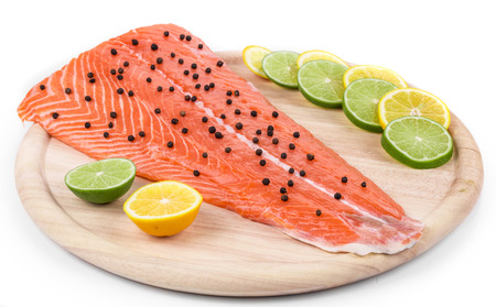 ready to cook food: Raw salmon fillet on platter. Isolated on a white background.