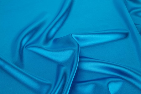 blue silk: Blue silk drapery. Isolated as a whole background.