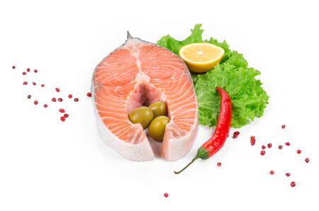 seafish: Fresh uncooked salmon steak. Isolated on a white background.