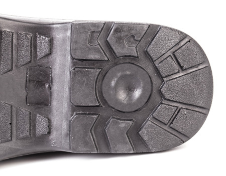 sole of shoe: Black shoe sole. Isolated on a white background.