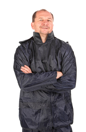outwear: Worker with arms crossed. Isolated on a white background. Stock Photo