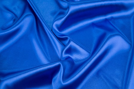 blue silk: Blue silk background. Texture close up on the whole background.