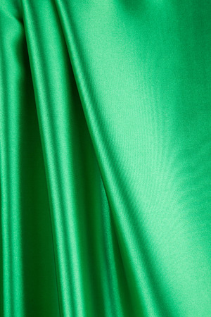 satiny cloth: Green silk background. Close up on the whole background.