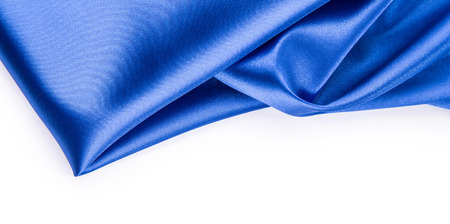 Blue silk drapery. Close up located on the white background.
