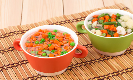 sued: Fresh homemade vegetable soups. Close up located on the wooden background. Stock Photo