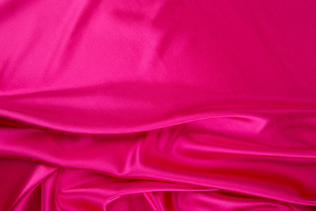 satiny cloth: Pink silk drapery. Isolated as a whole background.